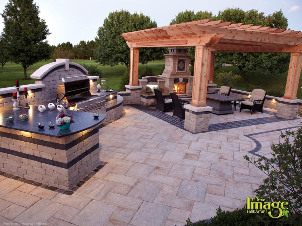 Unilock paver patio with outdoor kitchen pergola outdoor fireplace