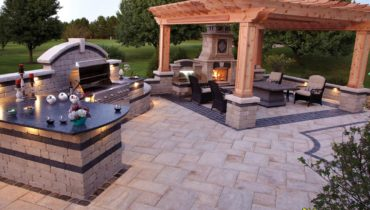 Unilock paver patio with outdoor kitchen, pergola & outdoor fireplace